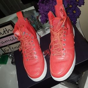 Nike Shoes - Tangerine orange leather high top air force one.